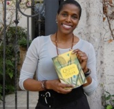Natalie Baszile holds book