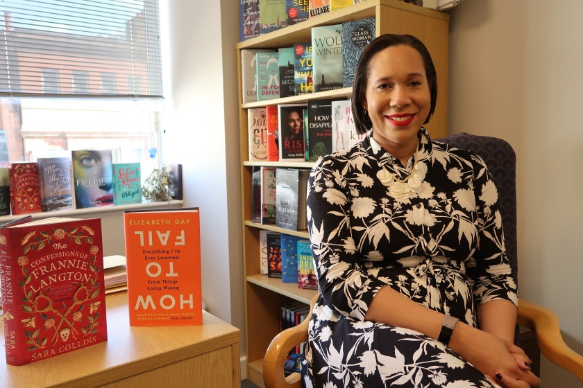 Literary agent, Nelle Andrews sits in her office